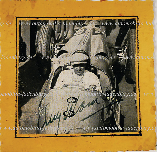 autographed newspaper cutting, August Momberger in an Auto Union car - hammer price 401 €